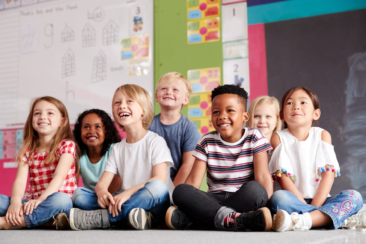 smiling children in a classroom